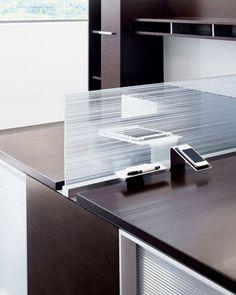 Gunlocke – Silea Open Office  Silea Open Office desk in walnut veneer and glass by Gunlocke, 800-828-6300; gunlocke.com.