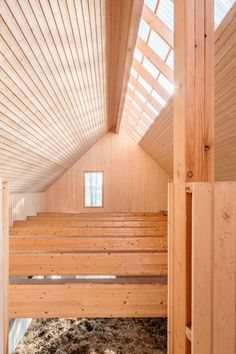 The use of untreated timber cladding helps to regulate humidity inside these stables, which is important for the horses' health.