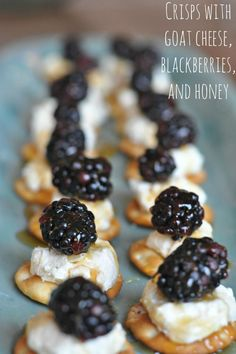 There is no appetizer more perfect than this simple assembly of crispbread or cracker and goat cheese topped with a big, fresh, juicy blackberry and a drizzle of mild honey.