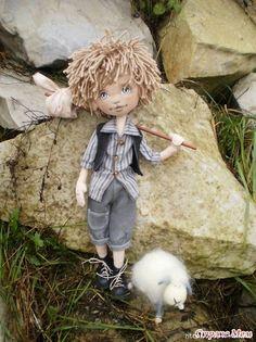 Cute boy crocheted doll