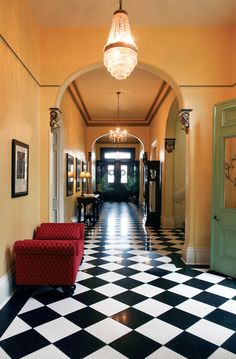 The entryway to Sherry and Kirk Wright's 1869 home opens up to a 55-foot black and white marble, checkered hallway.
