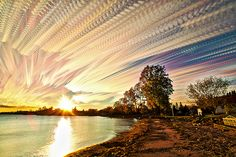 Fire and Smoke - Matt Molloy is an artist, musician and photographer who has a brilliantly unique and artistic style of smearing sunsets and skies together by photo stacking multiple time-lapse images.