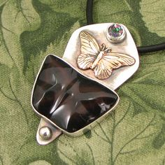 """Rainbow Obsidian Butterfly """"Becoming"""" pendant - Sterling with Rainbow Topaz stone and Brass Butterfly - OOAK by marybird on Etsy"""