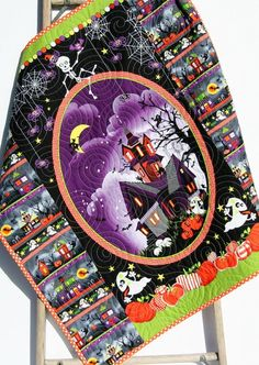 Halloween Quilt, Baby Blanket, Black Purple Orange Green Haunted House Pumpkin Spiders Webs Ghost Bats Stroller Blanket Ready to Ship by SunnysideDesigns2 #handmadequilts #babygifts #nursery #uniquegifts #gifts