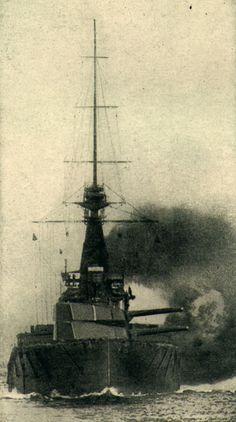 British battleship firing a broadside