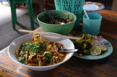 "Khao soi or khao soy is a Burmese-influenced dish served widely in northern Laos and northern Thailand.[1] The name means ""cut rice"" in Thai, although it is possible that it is simply a corruption of the Burmese word for noodles which is just ""khao swè"" which may account for the variations. Traditionally, the dough for the rice noodles is spread out on a cloth stretched over boiling water. After steaming the large sheet noodle is then rolled and cut with scissors. Lao khao soi is still made…"