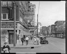 Coca-Cola Company; sign downtown at Hutchinson Drugs (273 East Main); Hammel's Men's Wear (273 West Main); Reed's Millinery (310 West Main); Schulte United Department Store (236-246 West Main); exterior view looking down West Main,, 1939. Kenyucky Digital Library, Lafayette Studios photographs: 1930s decade, 1930-1939.