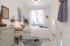 White simple and elegant bedroom decor.