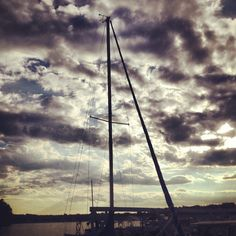Sailboat and clouds at Lake Hickory, North Carolina.