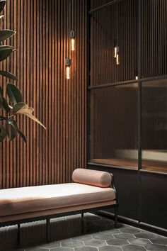 The millennial pink day bed in this home spa contrasts beautifully with black concrete tiles, teak cladding and the toughness of HEAVY METAL MATT BLACK. Spa Design, Home Spa Decor, Teak, Wood Spa, 70s Decor, Spa Rooms, Massage Room, Milan Design, Wood Interiors