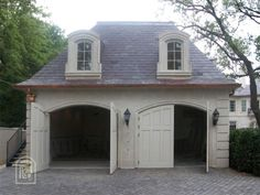 Carriage House with hip roof & arched doors: If we could transport this to my driveway!!