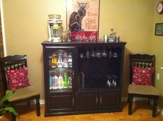 refinished kitchen cabinets repurposed entertainment center i added a bathroom mirror 1806