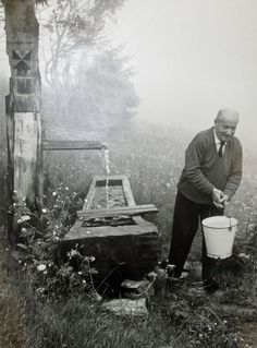 Heidegger - drawing water at his hut in Todtnauberg, Black Forest, Germany.