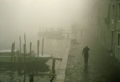 """ITALY. Venice. Carnival. 1990. Waterfront of """"Canale della Giudecca"""" in the fog."""
