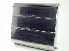 Charming Vintage Kitchen Wrap Dispenser. $18.00, Via Etsy.