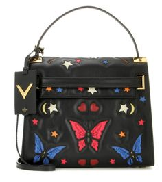 Valentino - My Rockstud embellished leather shoulder bag - We love the fresh, colourful look of this cheerful design by Valentino. Featuring an allover multicolured butterfly, star and moon design, the smooth leather is accented with gold-tone hardware and the brand's signature pyramid studs. We adore this bag worn with denim at the weekend or with a sleek pencil skirt to the office. seen @ www.mytheresa.com