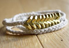 simple twine and hex-nut bracelet. I could probably make this. You know...in my spare time :)