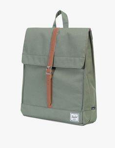 From Herschel Supply Co., the City Mid-Volume backpack in Lichen Green. Featuring signature striped fabric liner, magnetic strap closure with metal pin clip, hidden external zippered storage sleeve and classic woven label.  • City Mid-Volume backpack in