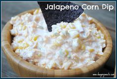 I do this same dip except mine is kind of a heart attack waiting to happen. Block of cream cheese, stick of butter, can of white shoepeg corn and chopped jalapenos to taste. Melt the cream cheese and butter together and then add the corn with the juice (drain off some for thicker dip). Add jalapenos, serve hot with Scoops. Delish!