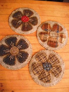 Lovely wool flower coasters. Woolie flower coasters with a tad of hand embroidery. These are made by me. I cleaned and felt some vintage wools to make these delightful coasters. They are approx. 4 1/2.