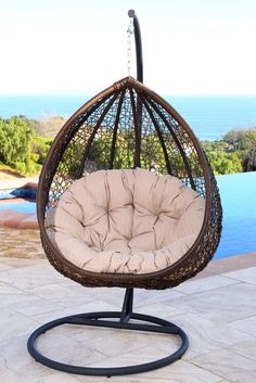 Materials: PE Wicker.  Water Resistant Cushions. Product Type:  Chair  Hammock. Cushion Included:  Yes. Weight Capacity:  250 Pounds. Frame  Finish:  Black.