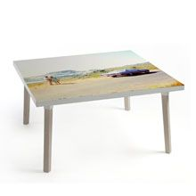 STEREO    A table with folding legs which can be hung on the wall as a picture when not in use. Finish designer Klaus Aalto