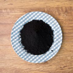 Activated charcoal http://www.prevention.com/beauty/natural-teeth-whitening/slide/2