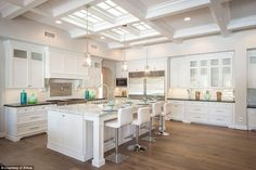 In the bright kitchen, features include imported hardwood floors and top-of-the-line appli...