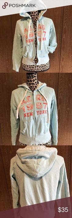 Aeropostale Blue Hoodie Cute light blue with Coral large zip up hoodie from Aeropostale.  Bust measures 20 inches zipped and it is 22 inches long   💜All sales are going towards college tuition for the spring semester! I am majoring in Elementary Education and I love it! Thanks so much for helping me reach my goal of becoming a Kindergarten teacher!💙 Aeropostale Tops Sweatshirts & Hoodies
