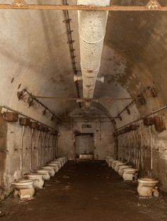 Row of toilets in abandoned German bunker. Links to more photos of this bunker. Interesting! Old Abandoned Buildings, Abandoned Property, Abandoned Asylums, Abandoned Library, Old Buildings, Abandoned Places, Haunted Places, Scary Places, Bunker