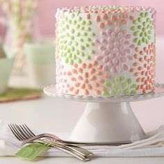 Polka-Dot Flower Cake: Celebrate a brand-new spring season with this buttercream-iced cake decorated with colorful flowers piped using the bead technique. Learn how to do this simple technique and more by taking The Wilton Method of Cake Decorating Course 1!