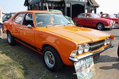1974 Ford Cortina 1600 Mk3 Orange with chrome detailing.