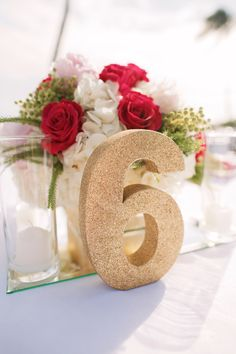 Gold table numbers & florals - Anna Kim Photography