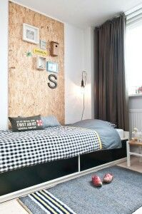 I believe that is a plywood sheet on the wall. And I do believe that I love it. Nice way to break up a boring wall