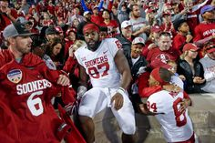 Oklahoma defensive end D.J. Ward (87) celebrates with fans as wide receiver Lee Morris (84) hugs a fan after an NCAA college football game Saturday, Oct. 21, 2017 against Kansas State in Manhattan, Kan. (Ian Maule/Tulsa World via AP)