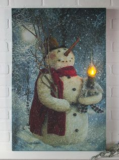 New large lighted canvas featuring the popular woodland snowman design.  The candle lights up and flickers!