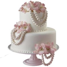 This cake design is stunning in its simplicity. Pretty fondant pearls are enhanced with Pearl Dust. Fresh flowers add a hint of color.