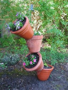 "You may have already seen these cute little planters, often called ""Tipsy Pots"". I decided to make one last year and liked it so much I've r. Potato Vines, Short Plants, Outdoor Sculpture, Garden Sculptures, Square Foot Gardening, Colorful Plants, Decks And Porches, Outdoor Fun, Outdoor Ideas"