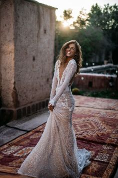 The sparkly beaded fishnet and fringing of our #Estelle mermaid wedding gown shimmers beautifully in the Moroccan sunshine.    Photo: by Tali Photography