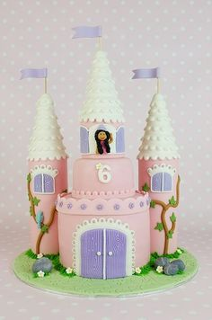 "Share Tweet +1 Pin Share This is part 2 of 3 on ""How to make a castle cake"". Part 1 can be viewed here. How to make the princess Step 1: Start with the princess' bodice. I simply rolled out some hot pink fondant, cut out a rectangle shape and made some curves for the… [read more...]"