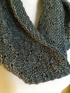 Lots of Lotus Cowl by Laura Snyder is is an easy cowl pattern that can be knit in either dk or worsted yarn. Solid colored or lightly tonal yarns are recommended.