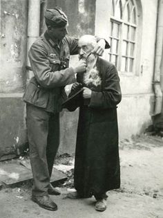 A young German soldier tries to humiliate an elderly Polish Jew by cutting his beard. Beard-cutting was a method of humiliation favored by many Germans. As it is with all bullies and their victims, the strong bear the real shame for preying on the weak. Jewish History, World History, World War Ii, Raza Aria, Anne Frank, Historical Photos, Wwii, The Past, Germany