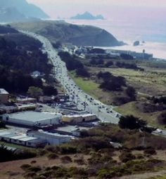 Highway 1 in Pacifica, CA: Our hotel is the one on the right, with the little structure sticking up, overlooking the ocean. <3