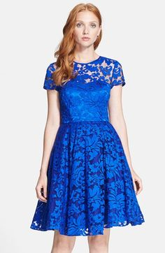 Free shipping and returns on Ted Baker London 'Caree' Lace Fit & Flare Dress at Nordstrom.com. Lacy flourishes texture the sheer overlay of an ornate party dress crowned with an illusion yoke and a flattering sweetheart bodice. Curve-highlighting princess seams release to a voluminous flared skirt.