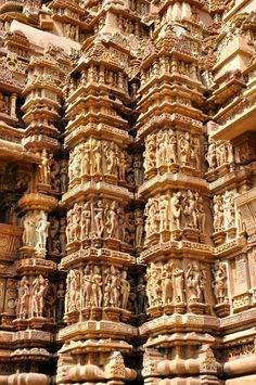 Thousands of intricately carved stone kama sutra statues adorn the Khajuraho Group of Monuments in India