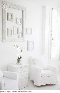 A few intentionally placed empty frames adds texture, dimension and visual interest to otherwise empty spaces. Try painting them in a similar hue for a more uniform look. White Rooms, White Walls, White Bedroom, Interior Exterior, Interior Design, Interior Paint, Empty Frames, Home Trends, White Houses