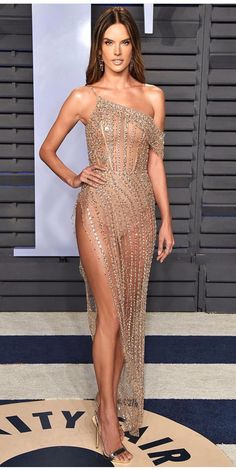 Alessandra Ambrosio sizzled in a see-through nude dress with strategically placed sparkles at the Vanity Fair Oscar Party in Beverly Hills on Sunday Ralph & Russo, Joan Smalls, Olivia Wilde, Emma Roberts, Emily Ratajkowski, Alessandra Ambrosio, Rosie Huntington Whiteley, Oscars, Sheer Dress
