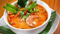 Tom Yum Goong (Phuket, Thailand) is served with rice noodle. The soup is made by good quality prawn, other spices and herbs, milk or coconut milk, red chili and mushroom. Where to eat: http://justgola.com/a/bang-pae-seafood-restaurant-176