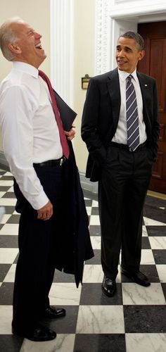 Vice President Joe Biden having a good laugh while President Obama looks on a little less amuzed.