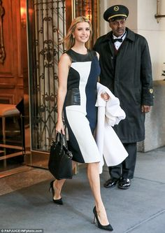 Not feeling the chill: Despite brisk morning temperatures, Ivanka donned a sleeveless dres...
